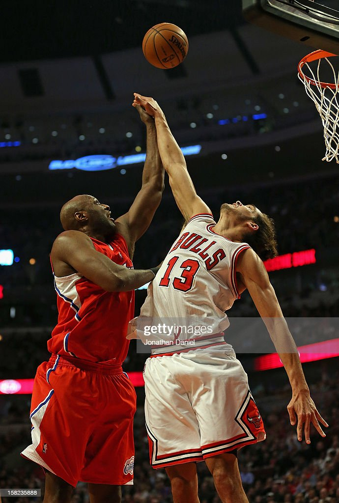 Joakim Noah #13 of the Chicago Bulls blocks a shot by Lamar Odom #7 of the Los Angeles Clippers at the United Center on December 11, 2012 in Chicago, Illinois.