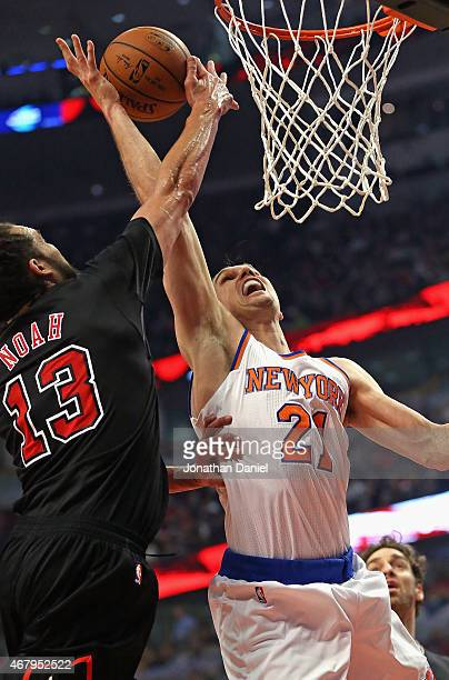 Joakim Noah of the Chicago Bulls blocks a shot by Lou Amundson of the New York Knicks at the United Center on March 28 2015 in Chicago Illinois NOTE...
