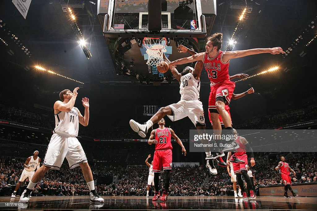 Joakim Noah #13 of the Chicago Bulls blocks Reggie Evans #30 of the Brooklyn Nets in Game Five of the Eastern Conference Quarterfinals during the 2013 NBA Playoffs on April 29 at the Barclays Center in the Brooklyn borough of New York City.