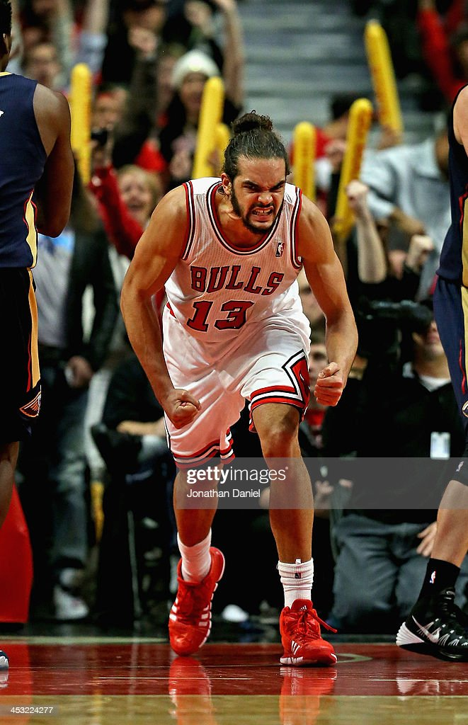 Joakim Noah #13 of the Chicago Bulls celebrates after a dunk against the New Orleans Pelicans at the United Center on December 2, 2013 in Chicago, Illinois. The Pelicans defeated the Bulls 131-128 in triple overtime.
