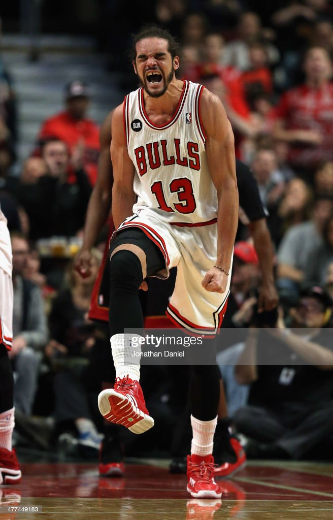 <a gi-track='captionPersonalityLinkClicked' href=/galleries/search?phrase=Joakim+Noah&family=editorial&specificpeople=699038 ng-click='$event.stopPropagation()'>Joakim Noah</a> #13 of the Chicago Bulls celebrates after being fouled during a game against the Miami Heat at the United Center on March 9, 2014 in Chicago, Illinois.