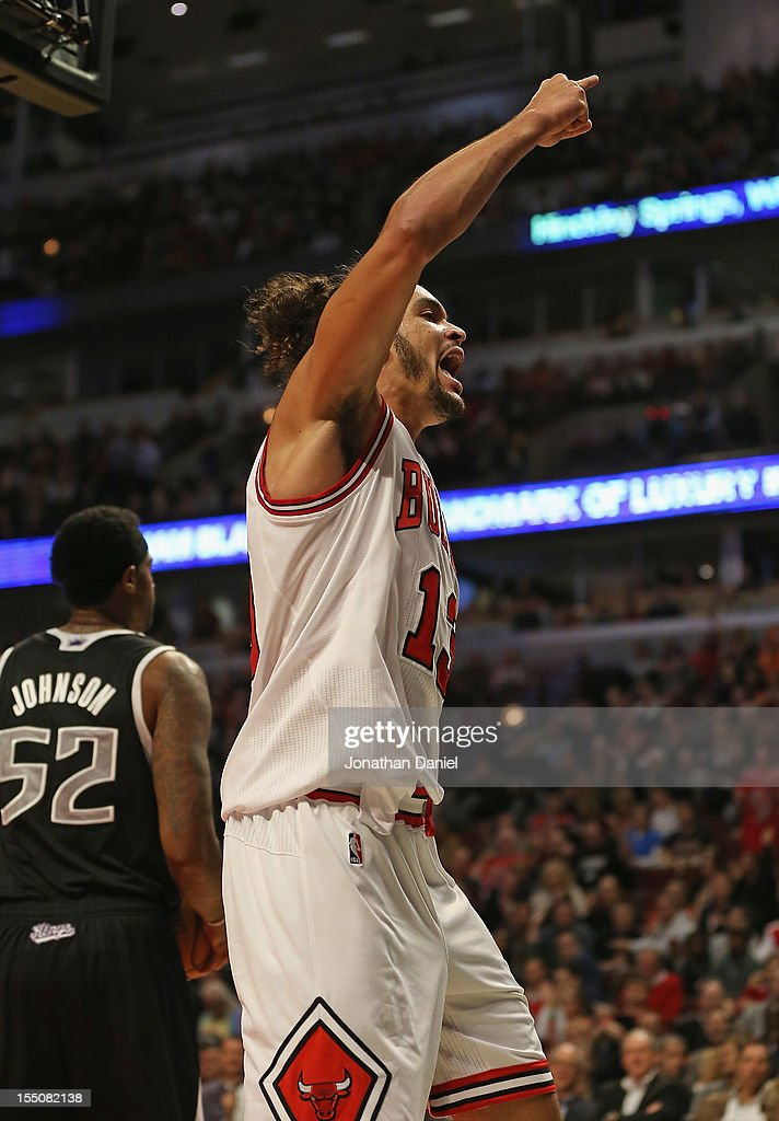 <a gi-track='captionPersonalityLinkClicked' href=/galleries/search?phrase=Joakim+Noah&family=editorial&specificpeople=699038 ng-click='$event.stopPropagation()'>Joakim Noah</a> #13 of the Chicago Bulls celebrates after being fouled against the Sacramento Kings at the United Center on October 31, 2012 in Chicago, Illinois. The Bulls defeated the Kings 93-87.