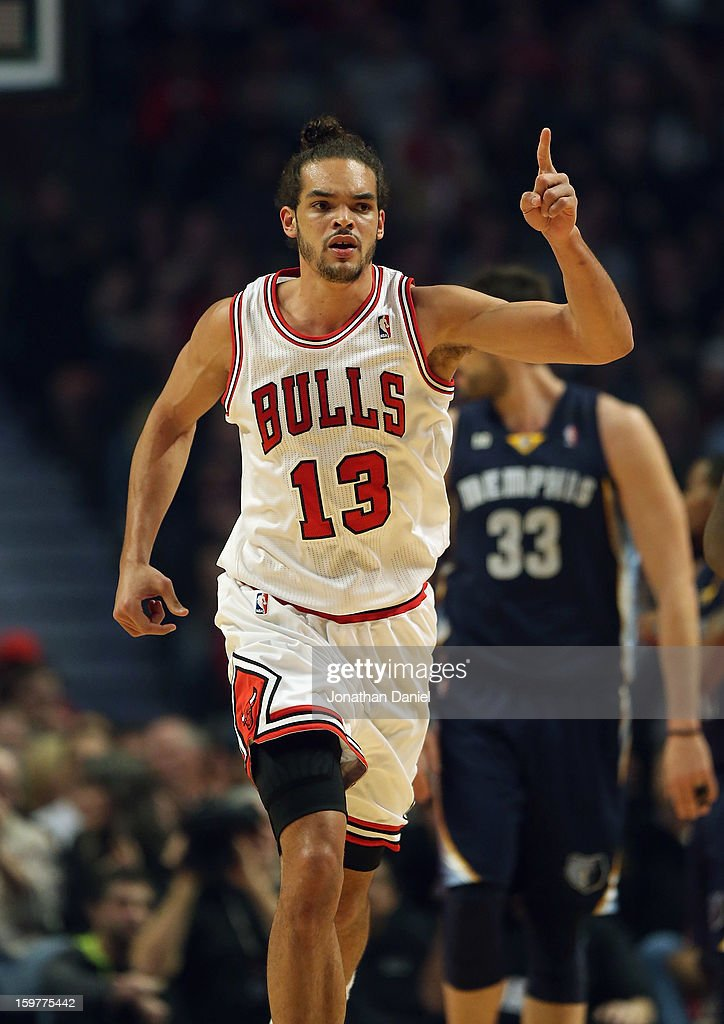 Joakim Noah #13 of the Chicago Bulls celebrates after dunking against the Memphis Grizzles at the United Center on January 19, 2013 in Chicago, Illinois. The Grizzlies defeated the Bulls 85-82 in overtime.