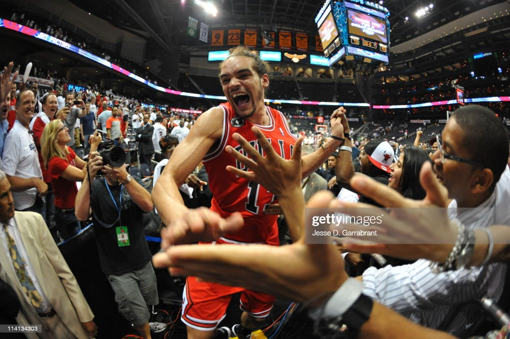 Joakim Noah #13 of the Chicago Bulls celebrates with fans after defeating the Atlanta Hawks in Game Six of the Eastern Conference Semifinals in the 2011 NBA Playoffs on May 12, 2011 at Phillips Arena in Atlanta, Georgia.