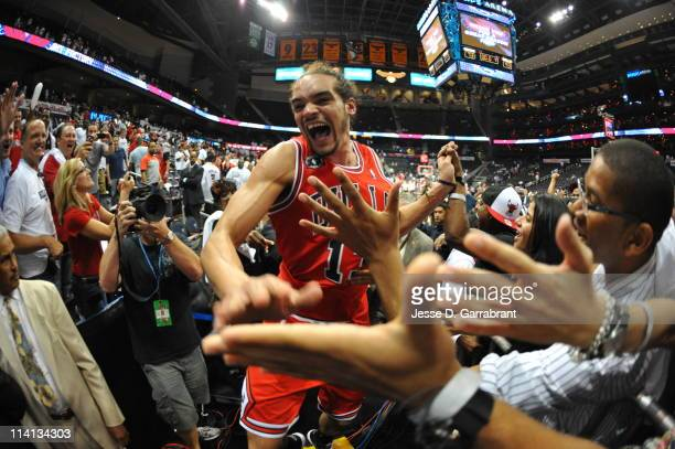 Joakim Noah of the Chicago Bulls celebrates with fans after defeating the Atlanta Hawks in Game Six of the Eastern Conference Semifinals in the 2011...
