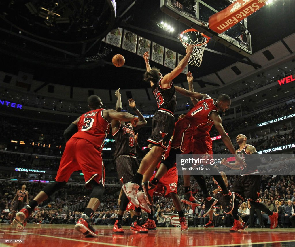 Joakim Noah #13 of the Chicago Bulls collides with Chris Bosh #1 of the Miami Heat as they try along with teammates to rebound the ball at the United Center on February 21, 2013 in Chicago, Illinois. The Heat defeated the Bulls 86-67.