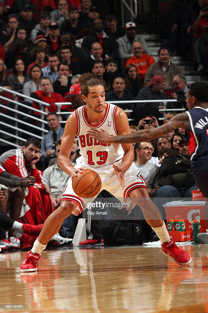 Joakim Noah #13 of the Chicago Bulls controls the ball against the Atlanta Hawks on January 14, 2013 at the United Center in Chicago, Illinois.