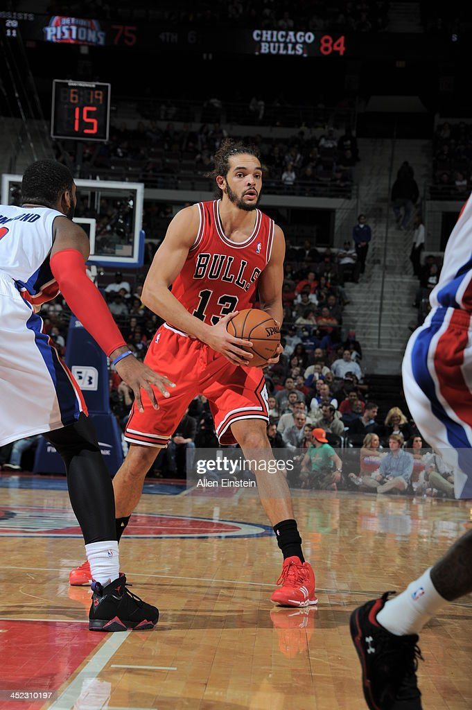 Joakim Noah #13 of the Chicago Bulls controls the ball against the Detroit Pistons on November 27, 2013 at The Palace of Auburn Hills in Auburn Hills, Michigan.