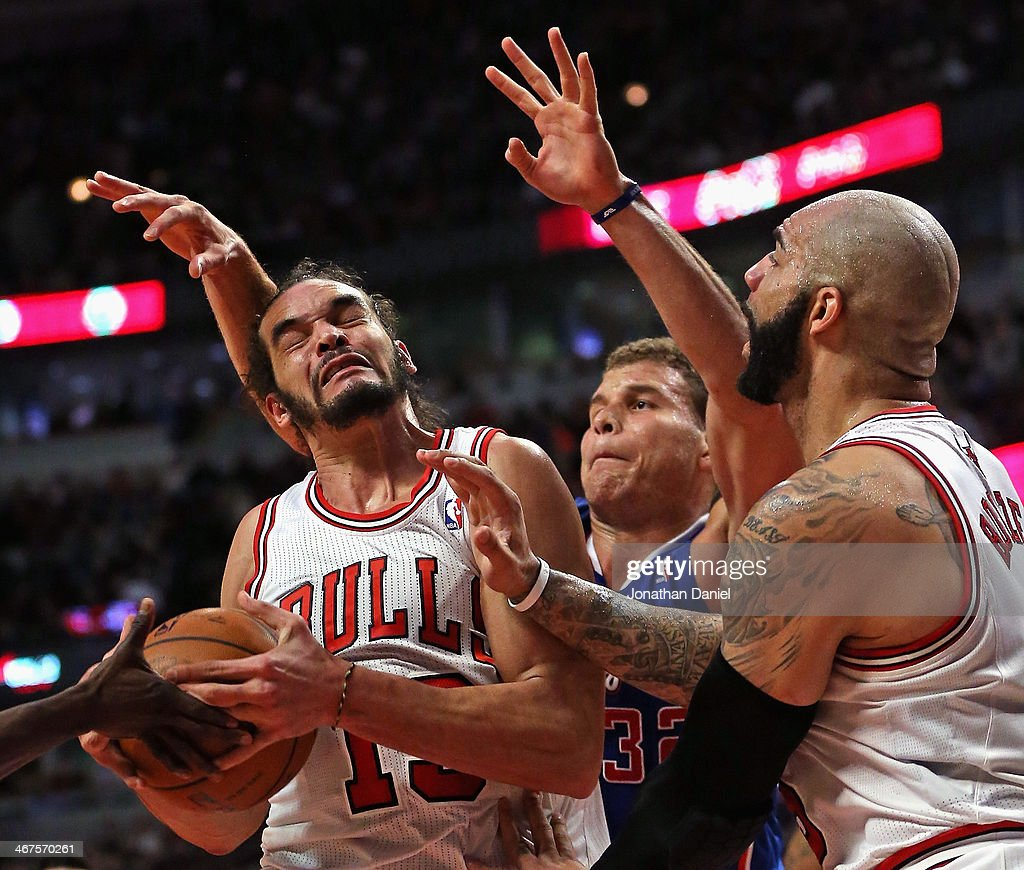 <a gi-track='captionPersonalityLinkClicked' href=/galleries/search?phrase=Joakim+Noah&family=editorial&specificpeople=699038 ng-click='$event.stopPropagation()'>Joakim Noah</a> #13 of the Chicago Bulls controls the ball next to teammate <a gi-track='captionPersonalityLinkClicked' href=/galleries/search?phrase=Carlos+Boozer&family=editorial&specificpeople=201638 ng-click='$event.stopPropagation()'>Carlos Boozer</a> #5 and under pressure from <a gi-track='captionPersonalityLinkClicked' href=/galleries/search?phrase=Blake+Griffin+-+Basketball+Player&family=editorial&specificpeople=4216010 ng-click='$event.stopPropagation()'>Blake Griffin</a> #32 of the Los Angeles Clippers at the United Center on January 24, 2014 in Chicago, Illinois. The Clippers defeated the Bulls 112-95.