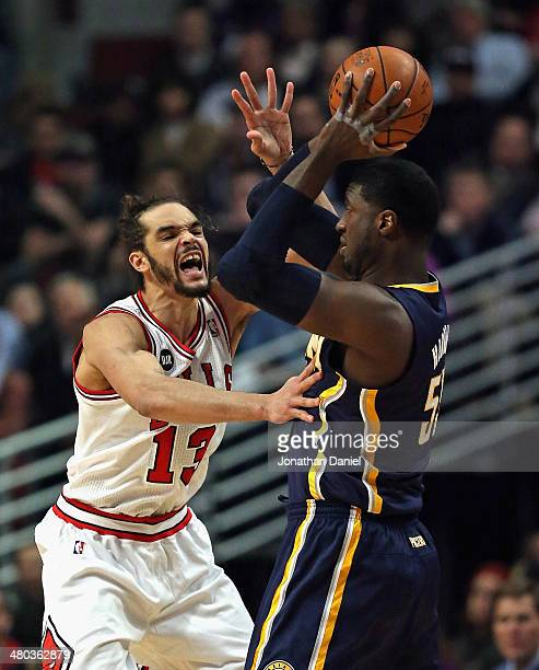 Joakim Noah of the Chicago Bulls defends against Roy Hibbert of the Indiana Pacers at the United Center on March 24 2014 in Chicago Illinois NOTE TO...