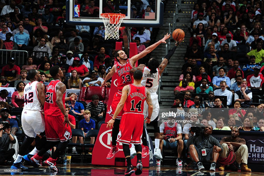 <a gi-track='captionPersonalityLinkClicked' href=/galleries/search?phrase=Joakim+Noah&family=editorial&specificpeople=699038 ng-click='$event.stopPropagation()'>Joakim Noah</a> #13 of the Chicago Bulls defends against the Atlanta Hawks on April 2, 2014 at Philips Arena in Atlanta, Georgia.