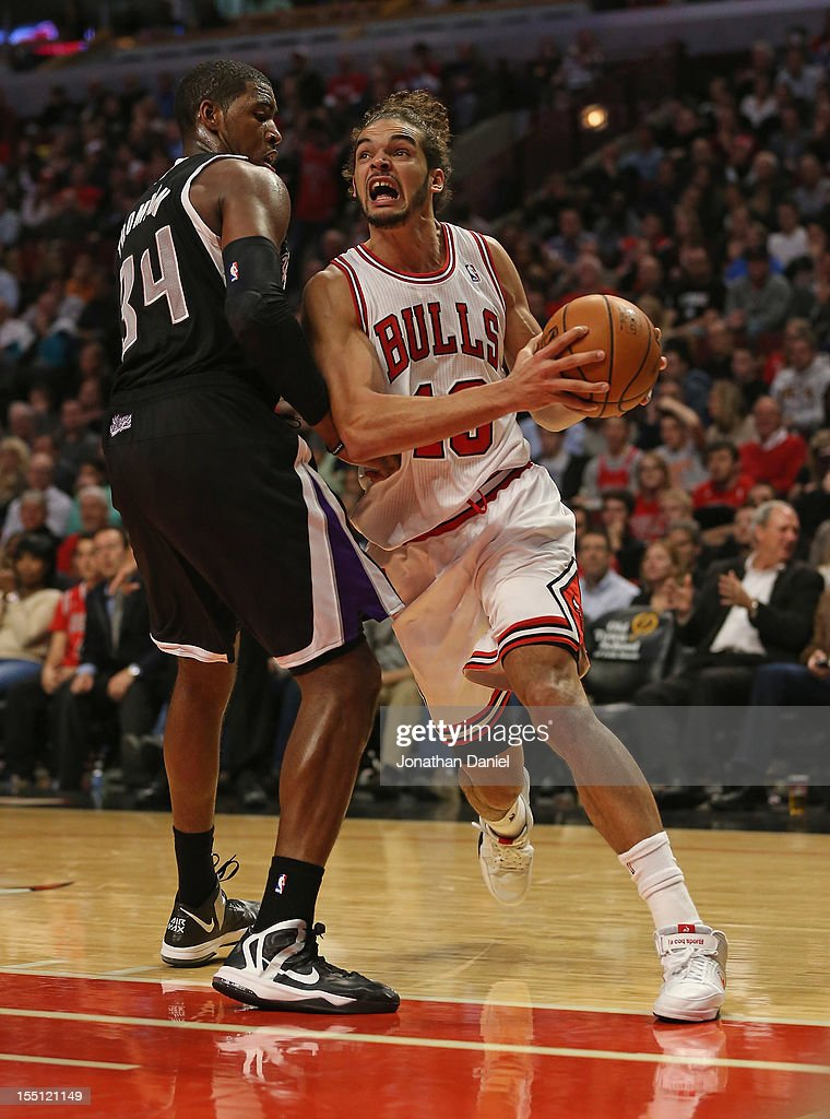 Joakim Noah #13 of the Chicago Bulls drives around Jason Thompson #34 of the Sacramento Kings at the United Center on October 31, 2012 in Chicago, Illinois. The Bulls defeated the Kings 93-87.