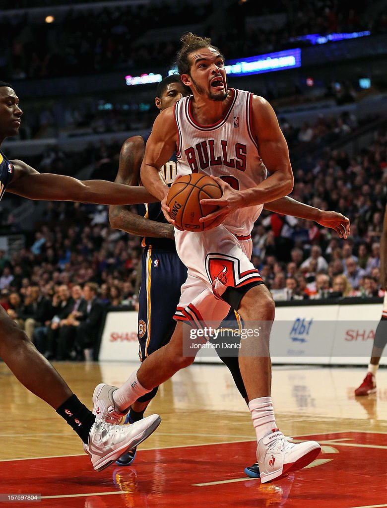 <a gi-track='captionPersonalityLinkClicked' href=/galleries/search?phrase=Joakim+Noah&family=editorial&specificpeople=699038 ng-click='$event.stopPropagation()'>Joakim Noah</a> #13 of the Chicago Bulls drives the lane against the Indiana Pacers at the United Center on December 4, 2012 in Chicago, Illinois. The Pacers defeated the Bulls 80-76.