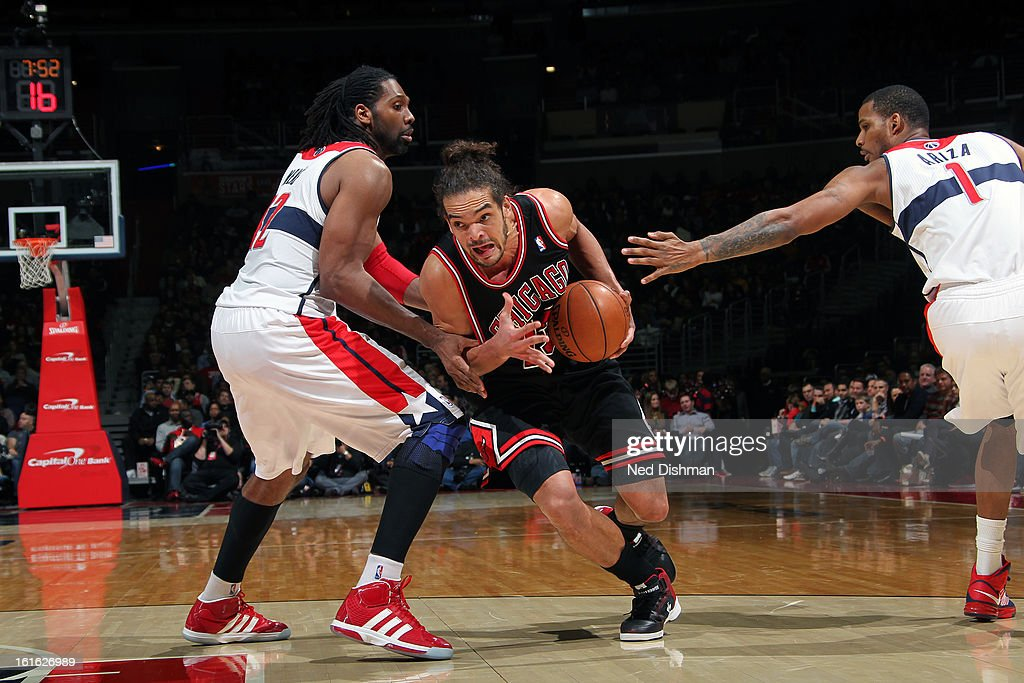 Joakim Noah #13 of the Chicago Bulls drives to the basket against the Washington Wizards at the Verizon Center on January 26, 2013 in Washington, DC.