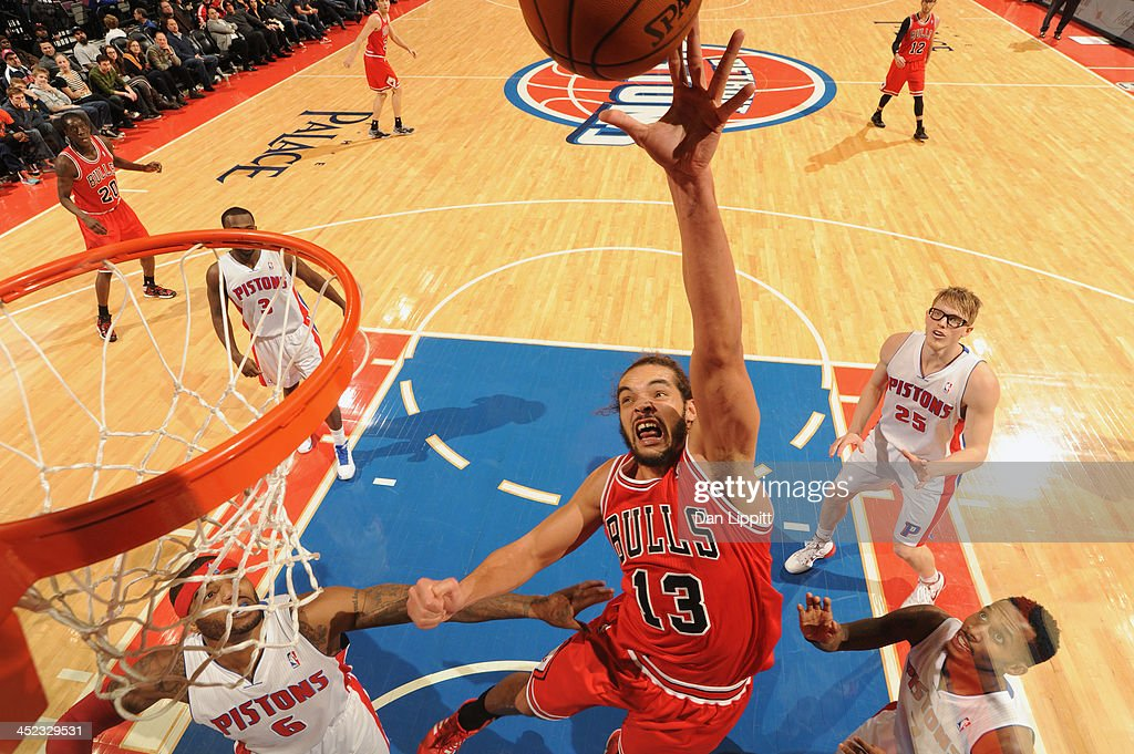 Joakim Noah #13 of the Chicago Bulls drives to the basket against the Detroit Pistons on November 27, 2013 at The Palace of Auburn Hills in Auburn Hills, Michigan.