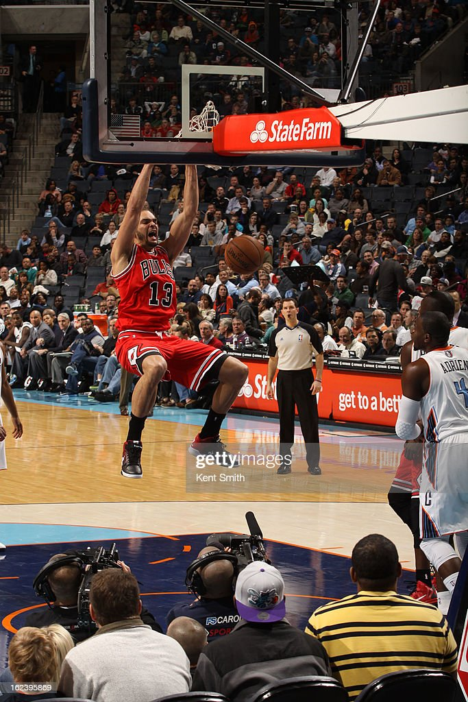<a gi-track='captionPersonalityLinkClicked' href=/galleries/search?phrase=Joakim+Noah&family=editorial&specificpeople=699038 ng-click='$event.stopPropagation()'>Joakim Noah</a> #13 of the Chicago Bulls dunks against the Charlotte Bobcats at the Time Warner Cable Arena on February 22, 2013 in Charlotte, North Carolina.