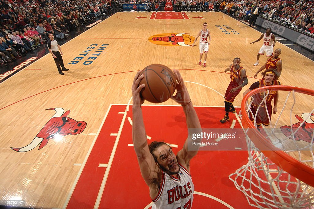 <a gi-track='captionPersonalityLinkClicked' href=/galleries/search?phrase=Joakim+Noah&family=editorial&specificpeople=699038 ng-click='$event.stopPropagation()'>Joakim Noah</a> #13 of the Chicago Bulls dunks against the Cleveland Cavaliers on December 21, 2013 at the United Center in Chicago, Illinois.