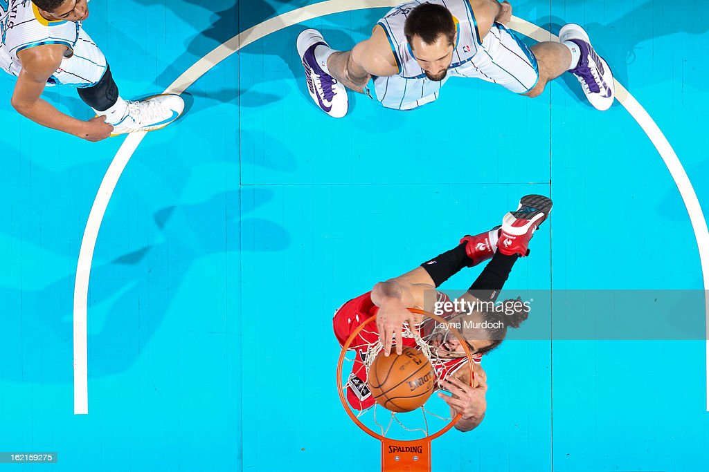 <a gi-track='captionPersonalityLinkClicked' href=/galleries/search?phrase=Joakim+Noah&family=editorial&specificpeople=699038 ng-click='$event.stopPropagation()'>Joakim Noah</a> #13 of the Chicago Bulls dunks against the New Orleans Hornets on February 19, 2013 at the New Orleans Arena in New Orleans, Louisiana.