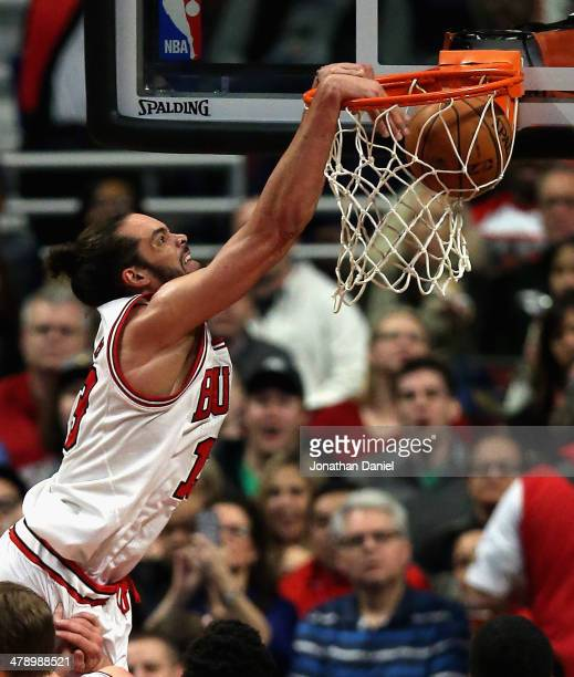 Joakim Noah of the Chicago Bulls dunks against the Sacramento Kings at the United Center on March 15 2014 in Chicago Illinois The Bulls defeated the...