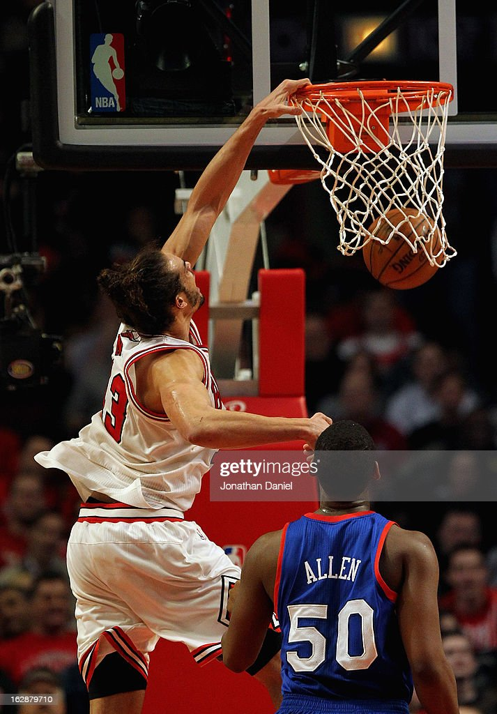 Joakim Noah #13 of the Chicago Bulls dunks over Lavoy Allen #50 the Phildelphia 76ers at the United Center on February 28, 2013 in Chicago, Illinois.