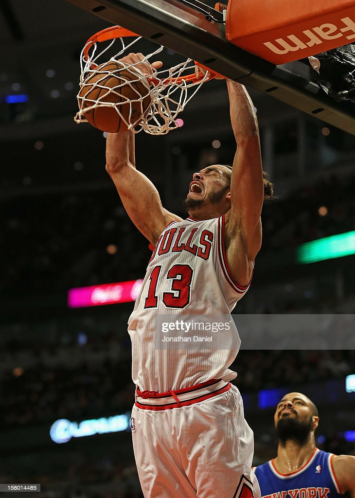 Joakim Noah #13 of the Chicago Bulls dunks over Tyson Chandler #6 of the New York Knicks at the United Center on December 8, 2012 in Chicago, Illinois. The Bulls defeated the Knicks 93-85.
