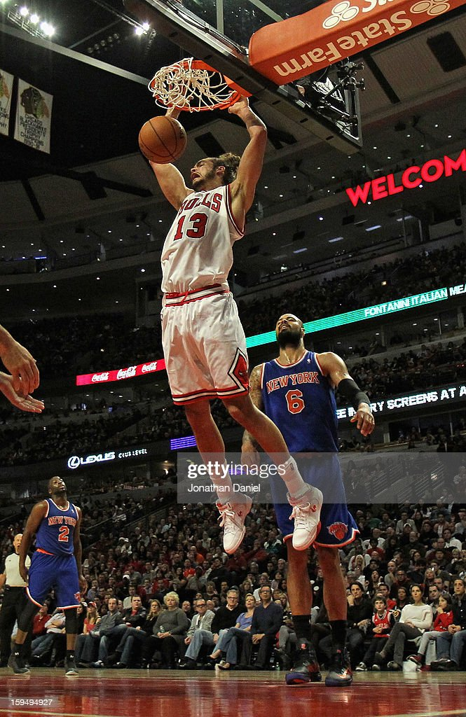<a gi-track='captionPersonalityLinkClicked' href=/galleries/search?phrase=Joakim+Noah&family=editorial&specificpeople=699038 ng-click='$event.stopPropagation()'>Joakim Noah</a> #13 of the Chicago Bulls dunks over <a gi-track='captionPersonalityLinkClicked' href=/galleries/search?phrase=Tyson+Chandler&family=editorial&specificpeople=202061 ng-click='$event.stopPropagation()'>Tyson Chandler</a> #6 of the New York Knicks at the United Center on December 8, 2012 in Chicago, Illinois. The Bulls defeated the Knicks 93-85.