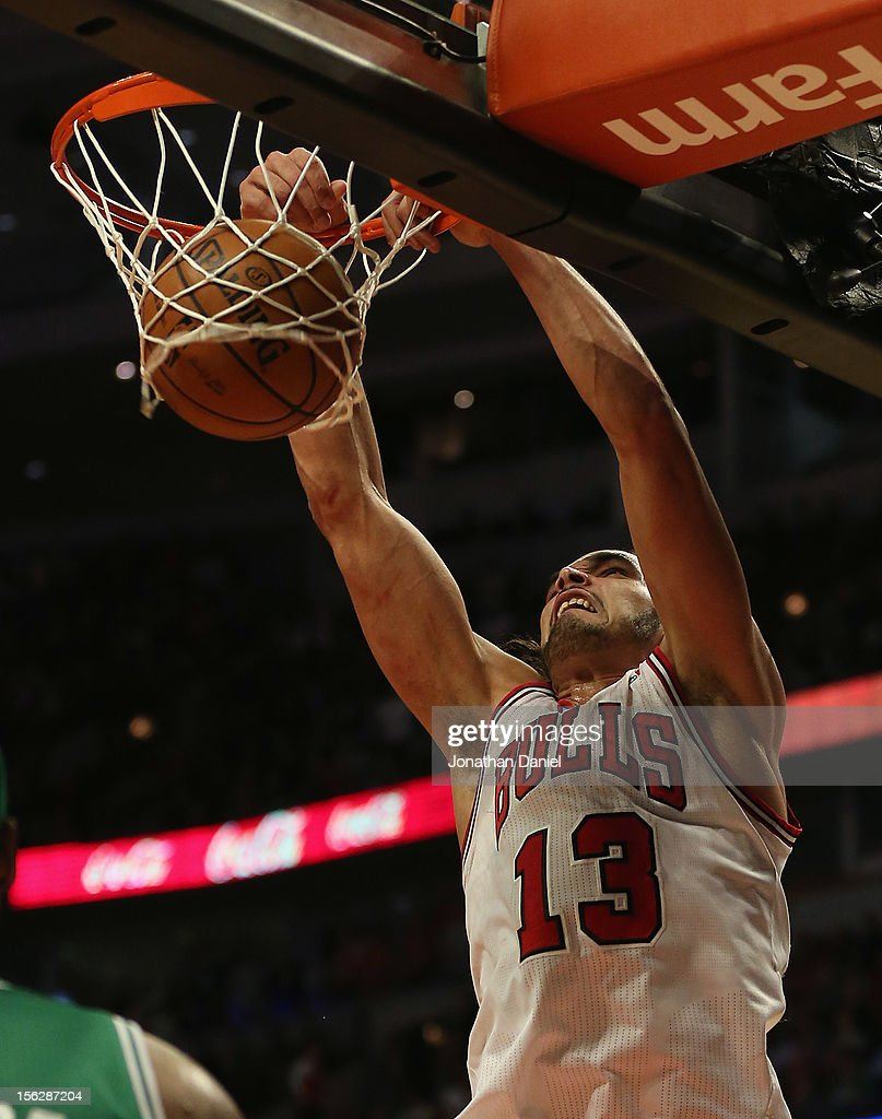 Joakim Noah #13 of the Chicago Bulls dunks the ball against the Boston Celtics at the United Center on November 12, 2012 in Chicago, Illinois. The Celtics defeated the Bulls 101-95.