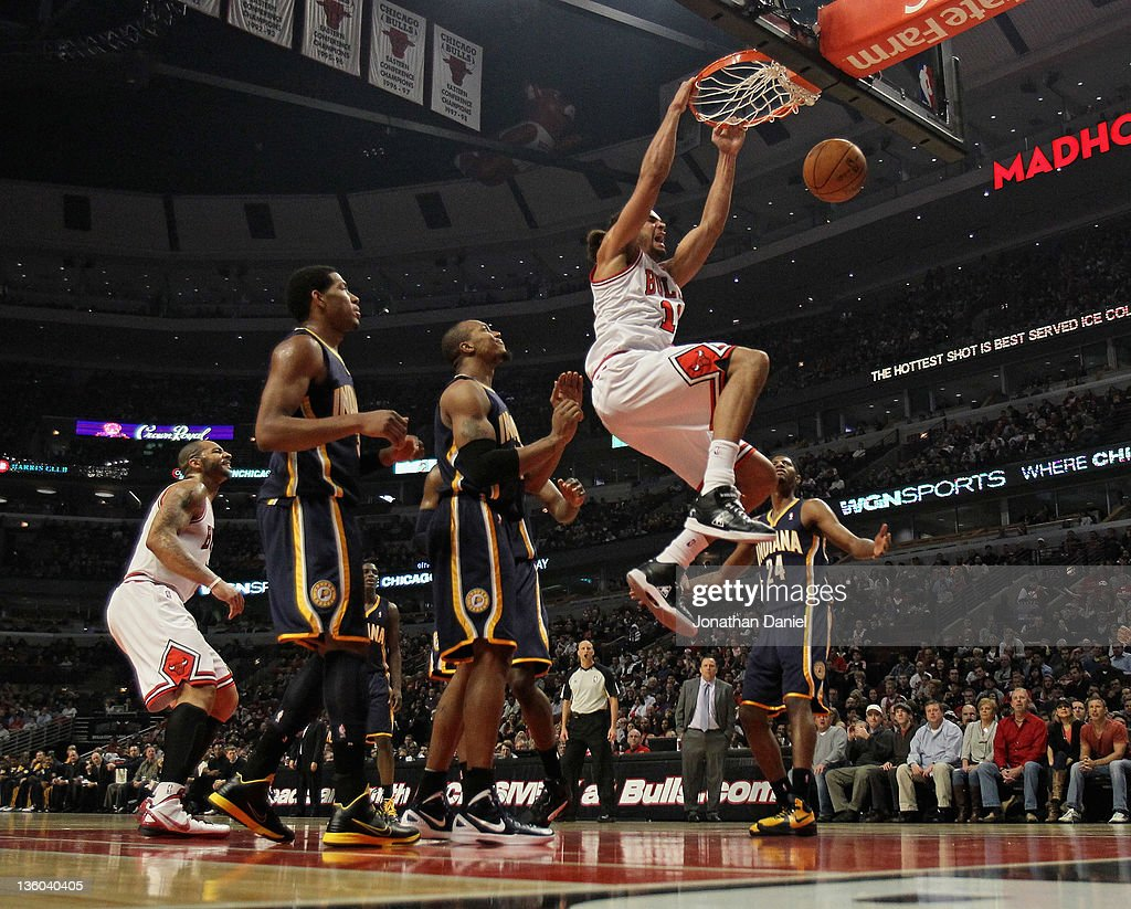 <a gi-track='captionPersonalityLinkClicked' href=/galleries/search?phrase=Joakim+Noah&family=editorial&specificpeople=699038 ng-click='$event.stopPropagation()'>Joakim Noah</a> #13 of the Chicago Bulls dunks the ball against the Indiana Pacers at the United Center on December 20, 2011 in Chicago, Illinois. The Bulls defeated the Pacers 93-85.