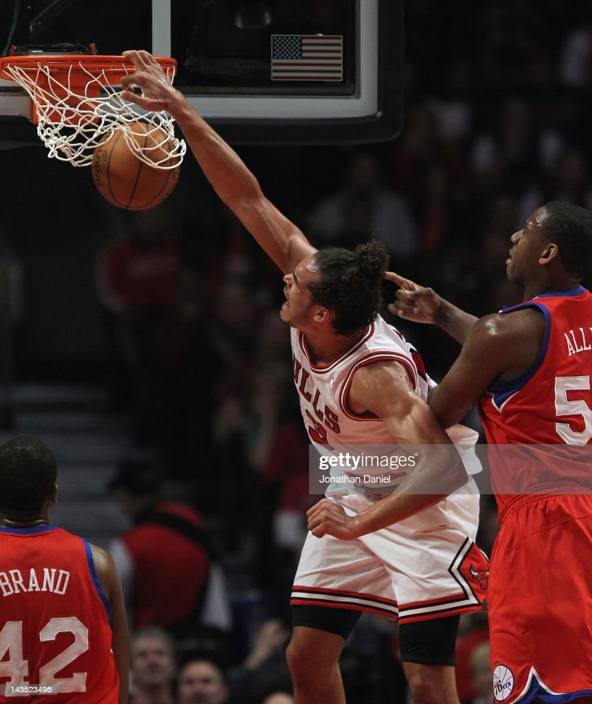 <a gi-track='captionPersonalityLinkClicked' href=/galleries/search?phrase=Joakim+Noah&family=editorial&specificpeople=699038 ng-click='$event.stopPropagation()'>Joakim Noah</a> #13 of the Chicago Bulls dunks the ball over <a gi-track='captionPersonalityLinkClicked' href=/galleries/search?phrase=Elton+Brand&family=editorial&specificpeople=201501 ng-click='$event.stopPropagation()'>Elton Brand</a> #42 and Lavoy Allen #50 of the Philadelphia 76ers in Game One of the Eastern Conference Quarterfinals during the 2012 NBA Playoffs at the United Center on April 28, 2012 in Chicago, Illinois.