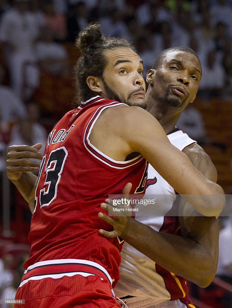 Joakim Noah of the Chicago Bulls fights for position against Chris Bosh of the Miami Heat during the NBA Eastern Conference playoffs against the Miami Heat at the AmericanAirlines Arena in Miami, Florida, Wednesday, May 6, 2013.