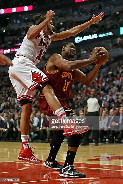 Joakim Noah of the Chicago Bulls fouls Andrew Bynum of the Cleveland Cavaliers at the United Center on November 11 2013 in Chicago Illinois NOTE TO...