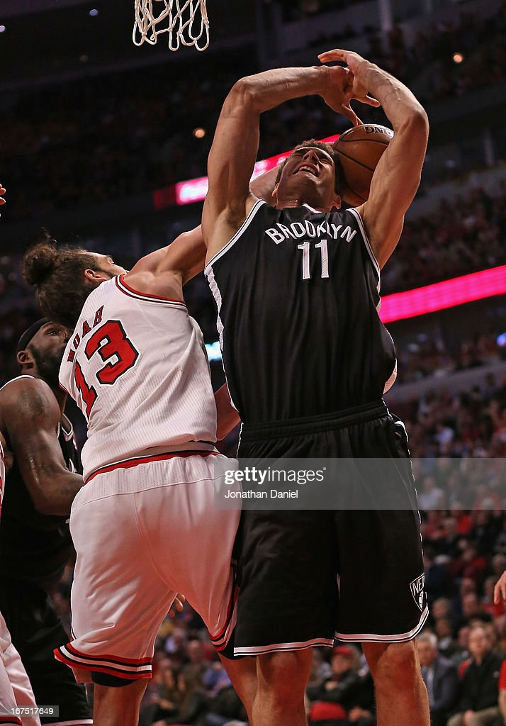 <a gi-track='captionPersonalityLinkClicked' href=/galleries/search?phrase=Joakim+Noah&family=editorial&specificpeople=699038 ng-click='$event.stopPropagation()'>Joakim Noah</a> #13 of the Chicago Bulls fouls <a gi-track='captionPersonalityLinkClicked' href=/galleries/search?phrase=Brook+Lopez&family=editorial&specificpeople=3847328 ng-click='$event.stopPropagation()'>Brook Lopez</a> #11 of the Brooklyn Nets in Game Three of the Eastern Conference Quarterfinals during the 2013 NBA Playoffs at the United Center on April 25, 2013 in Chicago, Illinois. The Bulls defeated the Nets 79-76.