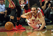 Joakim Noah of the Chicago Bulls gets off a pass as he hit the floor against the Milwaukee Bucks during the first round of the 2015 NBA Playoffs at...