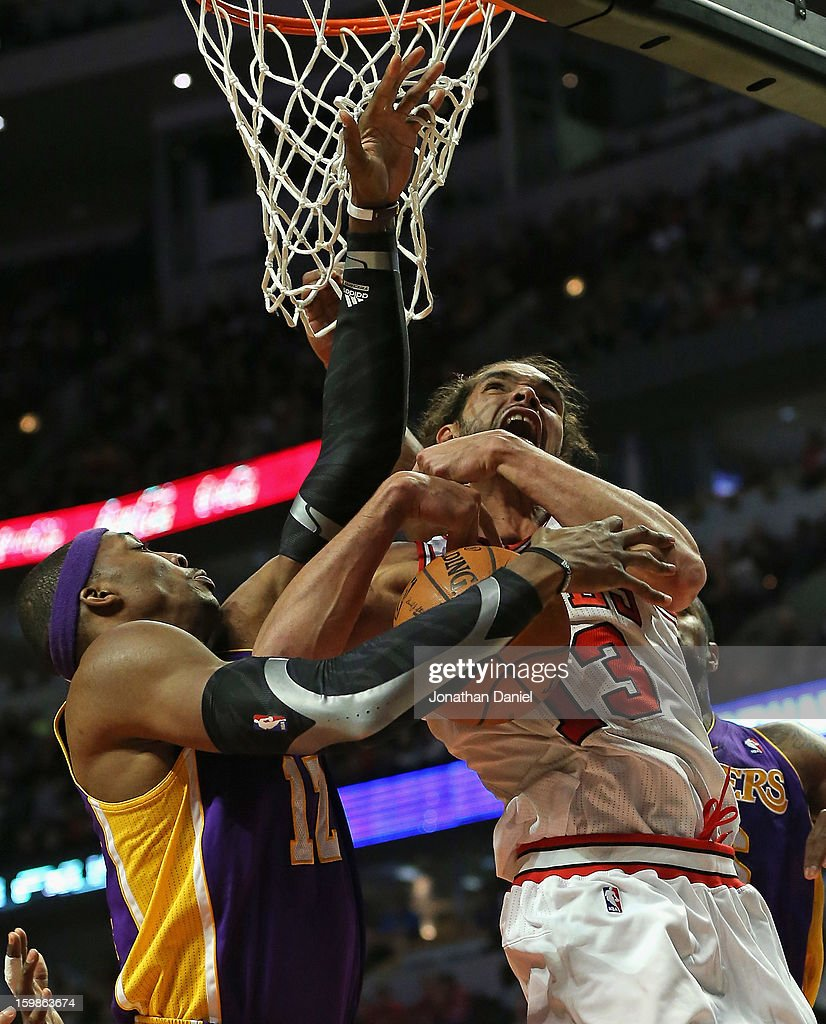 <a gi-track='captionPersonalityLinkClicked' href=/galleries/search?phrase=Joakim+Noah&family=editorial&specificpeople=699038 ng-click='$event.stopPropagation()'>Joakim Noah</a> #13 of the Chicago Bulls gets tangled up with <a gi-track='captionPersonalityLinkClicked' href=/galleries/search?phrase=Dwight+Howard&family=editorial&specificpeople=201570 ng-click='$event.stopPropagation()'>Dwight Howard</a> #12 of the Los Angeles Lakers at the United Center on January 21, 2013 in Chicago, Illinois. The Bulls defeated the Lakers 95-83.
