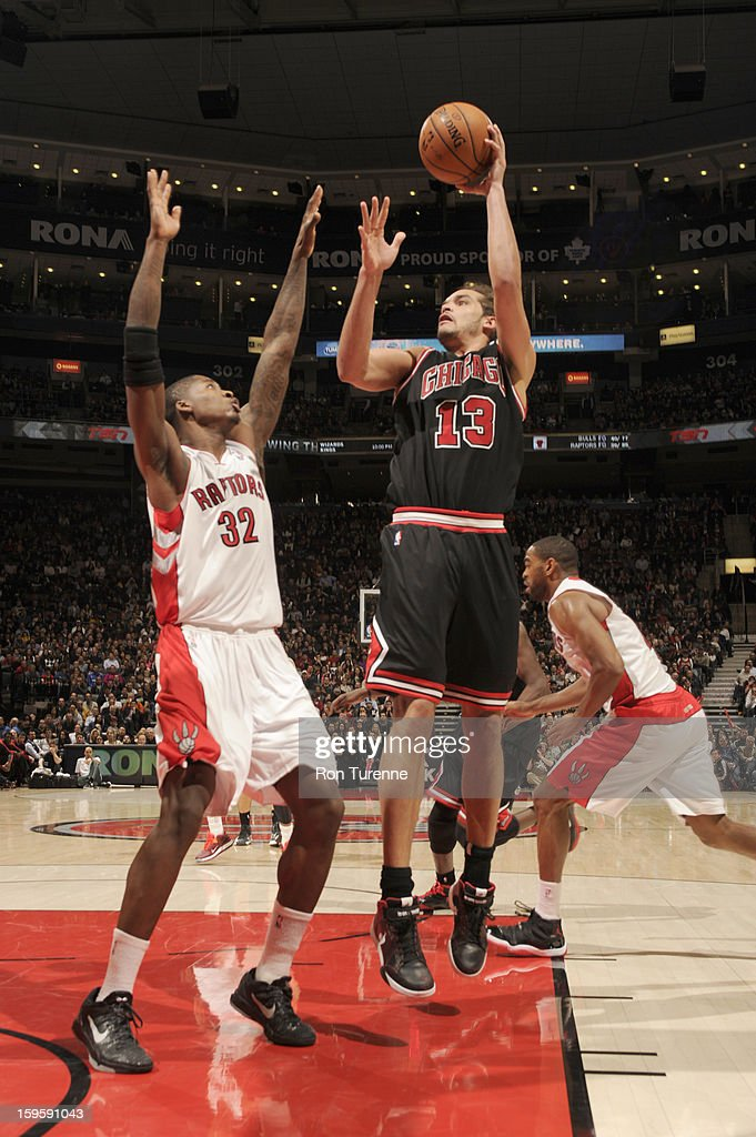 <a gi-track='captionPersonalityLinkClicked' href=/galleries/search?phrase=Joakim+Noah&family=editorial&specificpeople=699038 ng-click='$event.stopPropagation()'>Joakim Noah</a> #13 of the Chicago Bulls goes for a jump shot against Ed Davis #32 of the Toronto Raptors during the game between the Toronto Raptors and the Chicago Bulls on January 16, 2013 at the Air Canada Centre in Toronto, Ontario, Canada.