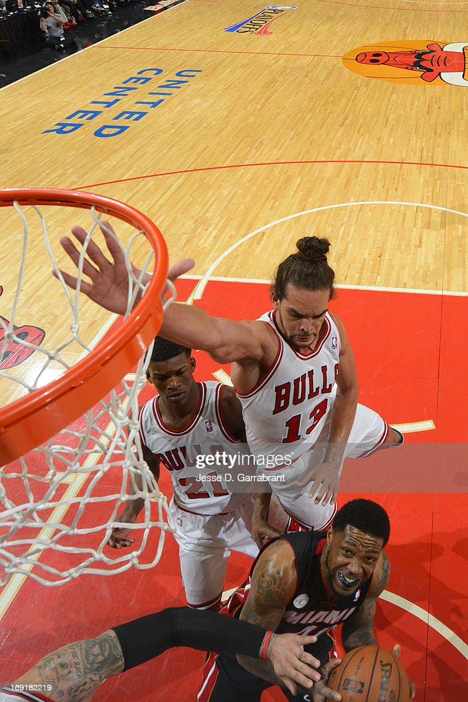 <a gi-track='captionPersonalityLinkClicked' href=/galleries/search?phrase=Joakim+Noah&family=editorial&specificpeople=699038 ng-click='$event.stopPropagation()'>Joakim Noah</a> #13 of the Chicago Bulls goes for the block against <a gi-track='captionPersonalityLinkClicked' href=/galleries/search?phrase=Udonis+Haslem&family=editorial&specificpeople=201748 ng-click='$event.stopPropagation()'>Udonis Haslem</a> #40 the Miami Heat in Game Four of the Eastern Conference Semifinals during the 2013 NBA Playoffs on May 13, 2013 at United Center in Chicago, Illinois.
