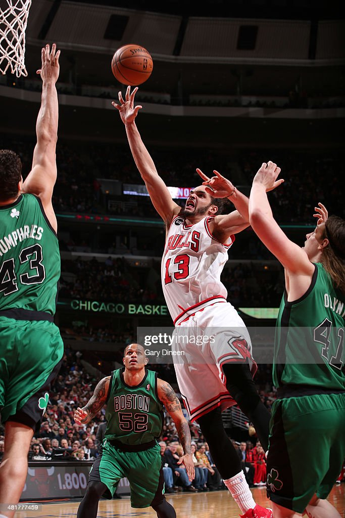 <a gi-track='captionPersonalityLinkClicked' href=/galleries/search?phrase=Joakim+Noah&family=editorial&specificpeople=699038 ng-click='$event.stopPropagation()'>Joakim Noah</a> #13 of the Chicago Bulls goes to the basket past against the Boston Celtics on March 31, 2014 at the United Center in Chicago, Illinois.