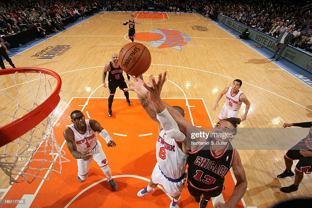 Joakim Noah #13 of the Chicago Bulls goes up for a rebound against Tyson Chandler #6 of the New York Knicks on January 11, 2013 at Madison Square Garden in New York City.