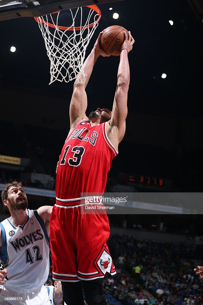 Joakim Noah #13 of the Chicago Bulls goes up for the dunk against the Minnesota Timberwolves during the game on April 9, 2014 at Target Center in Minneapolis, Minnesota.