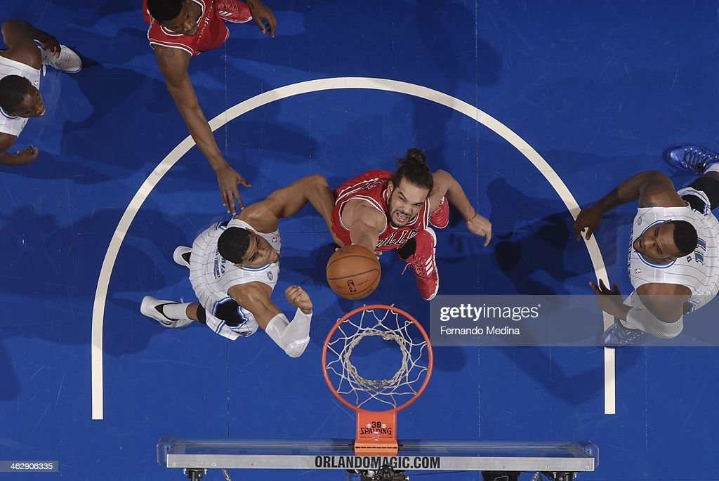 Joakim Noah #11 of the Chicago Bulls goes up for the layup against the Orlando Magic during the game on January 15, 2014 at Amway Center in Orlando, Florida.