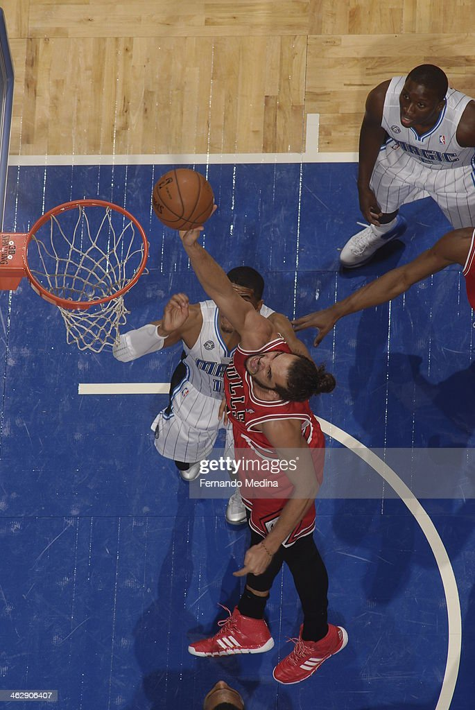 Joakim Noah #13 of the Chicago Bulls goes up for the layup against the Orlando Magic during the game on January 15, 2014 at Amway Center in Orlando, Florida.