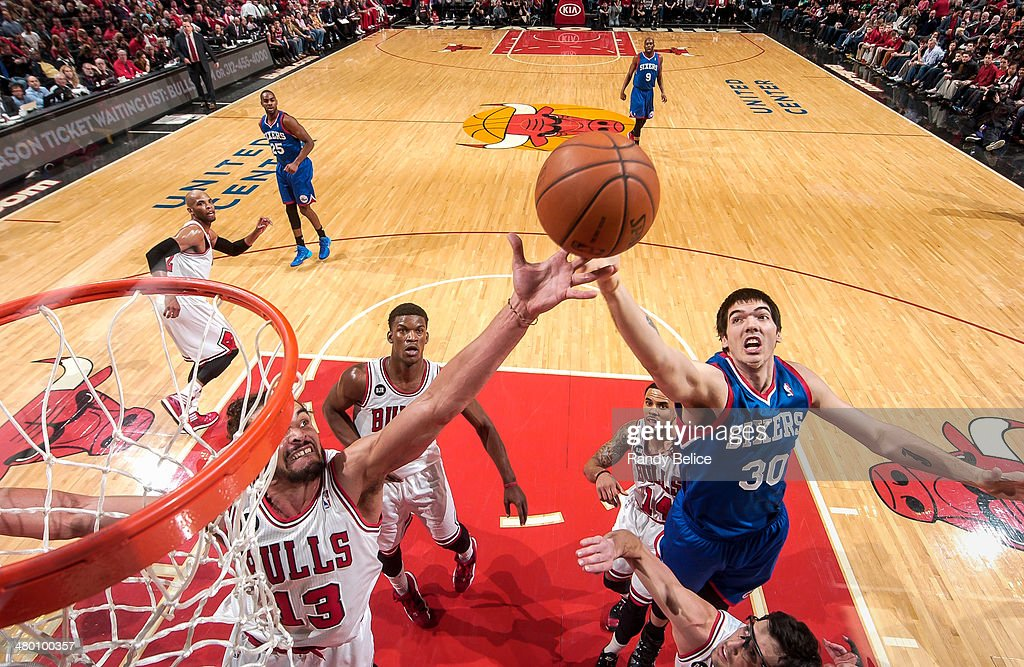 Joakim Noah of the Chicago Bulls grabs a rebound against Byron Mullens of the Philadelphia 76ers on March 22 2013 at the United Center in Chicago...