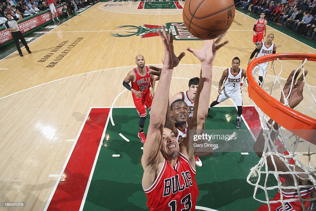Joakim Noah #13 of the Chicago Bulls grabs a rebound against Samuel Dalembert #21 of the Milwaukee Bucks on January 30, 2013 at the BMO Harris Bradley Center in Milwaukee, Wisconsin.