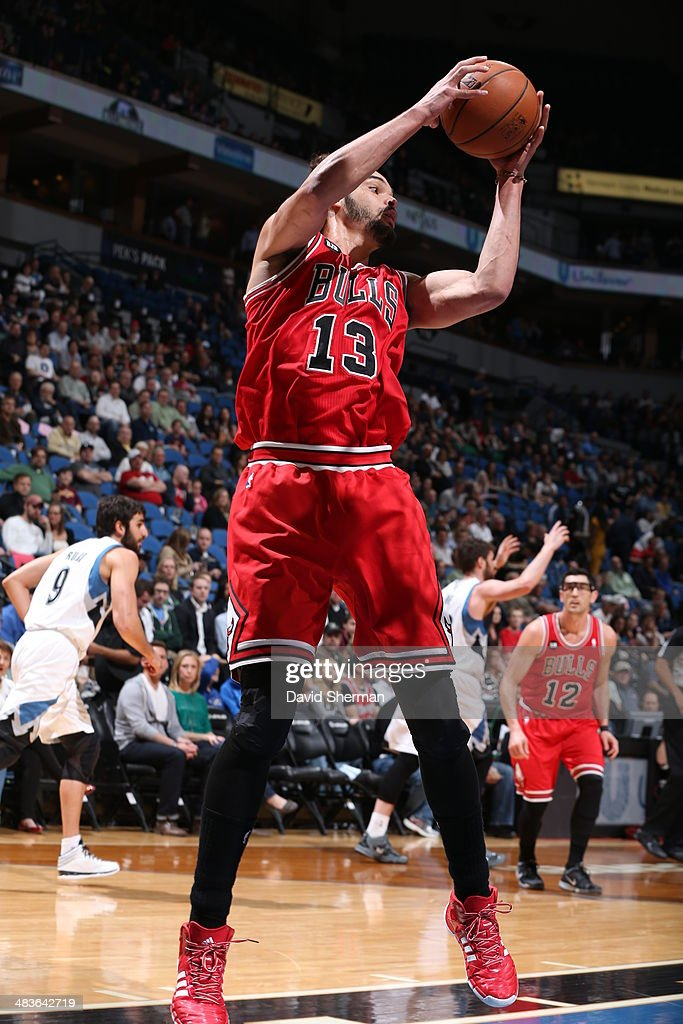 Joakim Noah #13 of the Chicago Bulls grabs a rebound against the Minnesota Timberwolves during the game on April 9, 2014 at Target Center in Minneapolis, Minnesota.