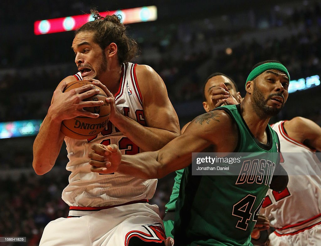Joakim Noah #13 of the Chicago Bulls grabs a rebound away from Chris Wilcox #44 of the Boston Celtics at the United Center on December 18, 2012 in Chicago, Illinois.