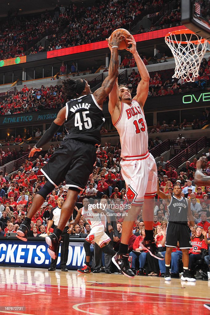 Joakim Noah #13 of the Chicago Bulls grabs a rebound from Gerald Wallace #45 of the Brooklyn Nets in Game Four of the Eastern Conference Quarterfinals during the 2013 NBA Playoffs on April 27, 2013 at United Center in Chicago, Illinois.