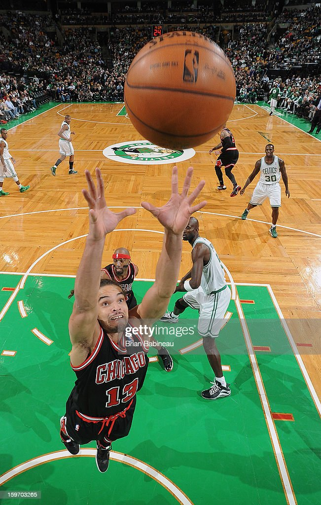 Joakim Noah #13 of the Chicago Bulls grabs the ball against the Boston Celtics on January 18, 2013 at the TD Garden in Boston, Massachusetts.