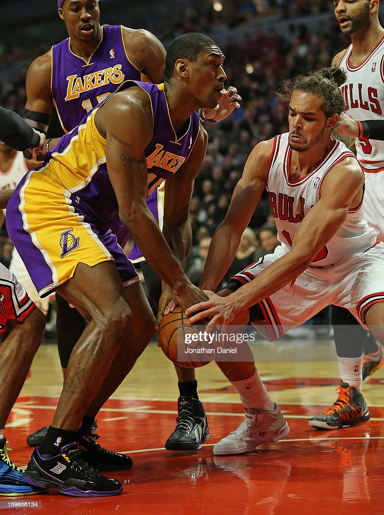 Joakim Noah #13 of the Chicago Bulls grabs the ball away from Metta World Peace #15 of the Los Angeles Lakers at the United Center on January 21, 2013 in Chicago, Illinois.