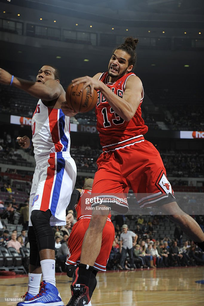 Joakim Noah #13 of the Chicago Bulls grabs the rebound against Greg Monroe #10 of the Detroit Pistons on December 7, 2012 at The Palace of Auburn Hills in Auburn Hills, Michigan.