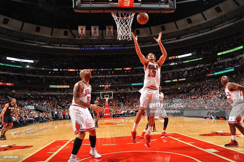 <a gi-track='captionPersonalityLinkClicked' href=/galleries/search?phrase=Joakim+Noah&family=editorial&specificpeople=699038 ng-click='$event.stopPropagation()'>Joakim Noah</a> #13 of the Chicago Bulls grabs the rebound against the Miami Heat on December 5, 2013 at United Center in Chicago, Illinois.
